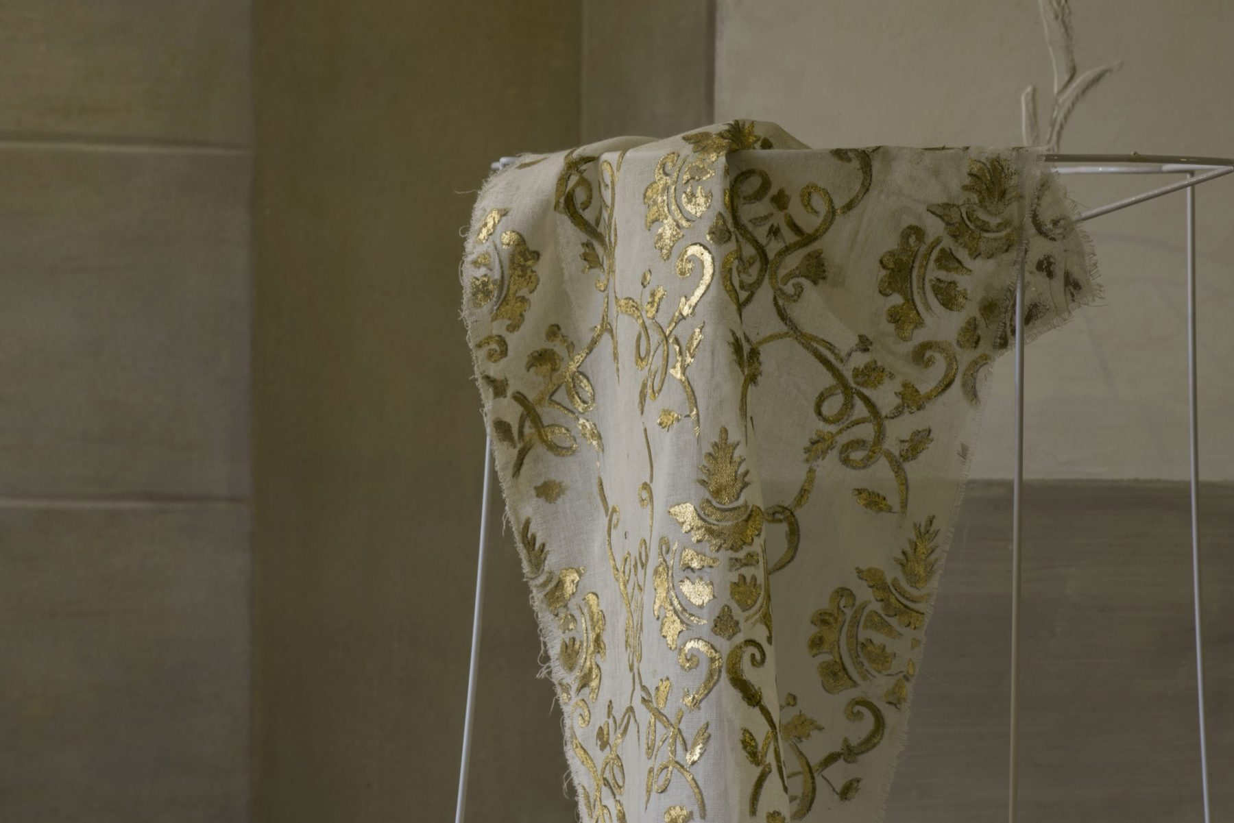 Hand painted golden fabric by Quadrature Interiors